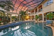 SUNSETS & SWIMMING EVERY EVENING ....WHAT A DREAM COME TRUE. - Single Family Home for sale at 8263 Archers Ct, Sarasota, FL 34240 - MLS Number is A4483993