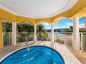 Enjoy a relaxing  jacuzzi soak after a workout. - Condo for sale at 14021 Bellagio Way #407, Osprey, FL 34229 - MLS Number is A4487552