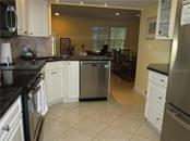 KITCHEN OPENED INTO DINING AREA - Condo for sale at 1087 W Peppertree Dr #221d, Sarasota, FL 34242 - MLS Number is A4493593