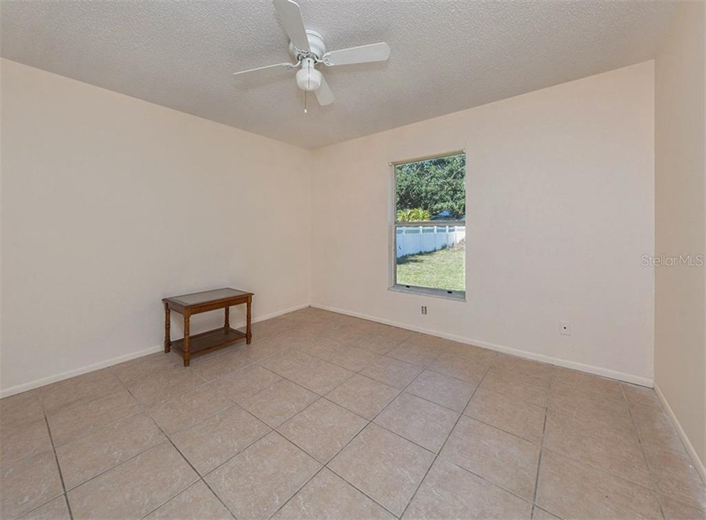 Bedroom - Single Family Home for sale at 10308 Grail Ave, Englewood, FL 34224 - MLS Number is N5911429
