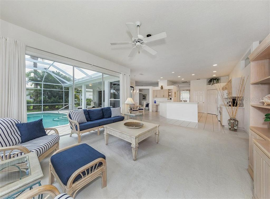 Family Room With Sliders That Open To The Pool And Lanai - Single Family Home for sale at 122 Ventana Way, Venice, FL 34292 - MLS Number is N5912714