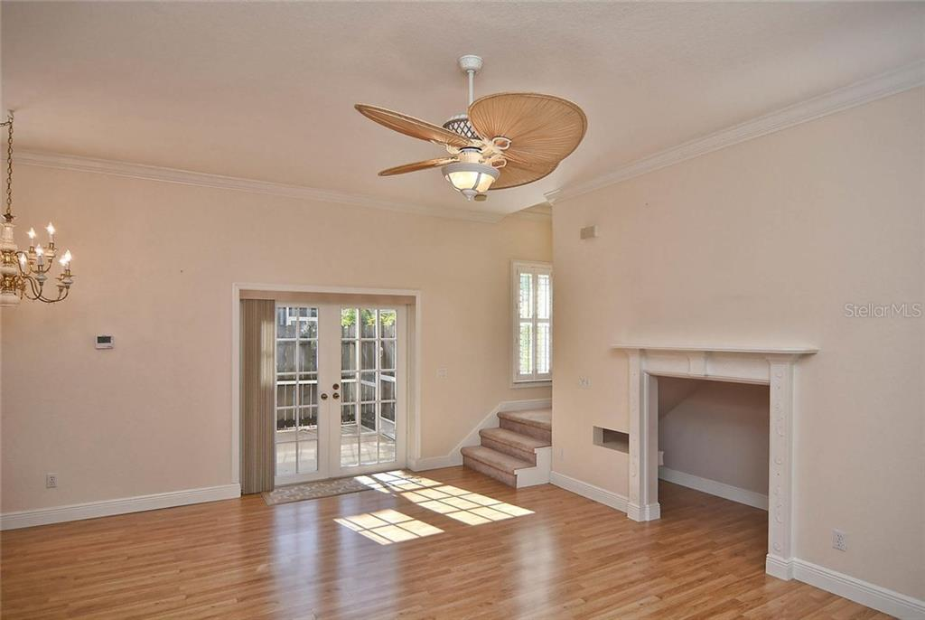 Living room with french door to lanai - Condo for sale at 501 Barcelona Ave #c, Venice, FL 34285 - MLS Number is N5913183