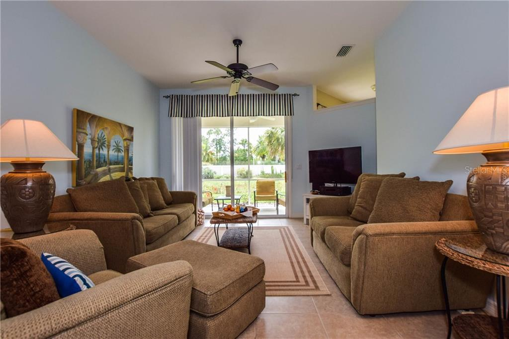 Living Room With Sliders To The Lanai - Villa for sale at 1641 Monarch Dr #1641, Venice, FL 34293 - MLS Number is N5913259