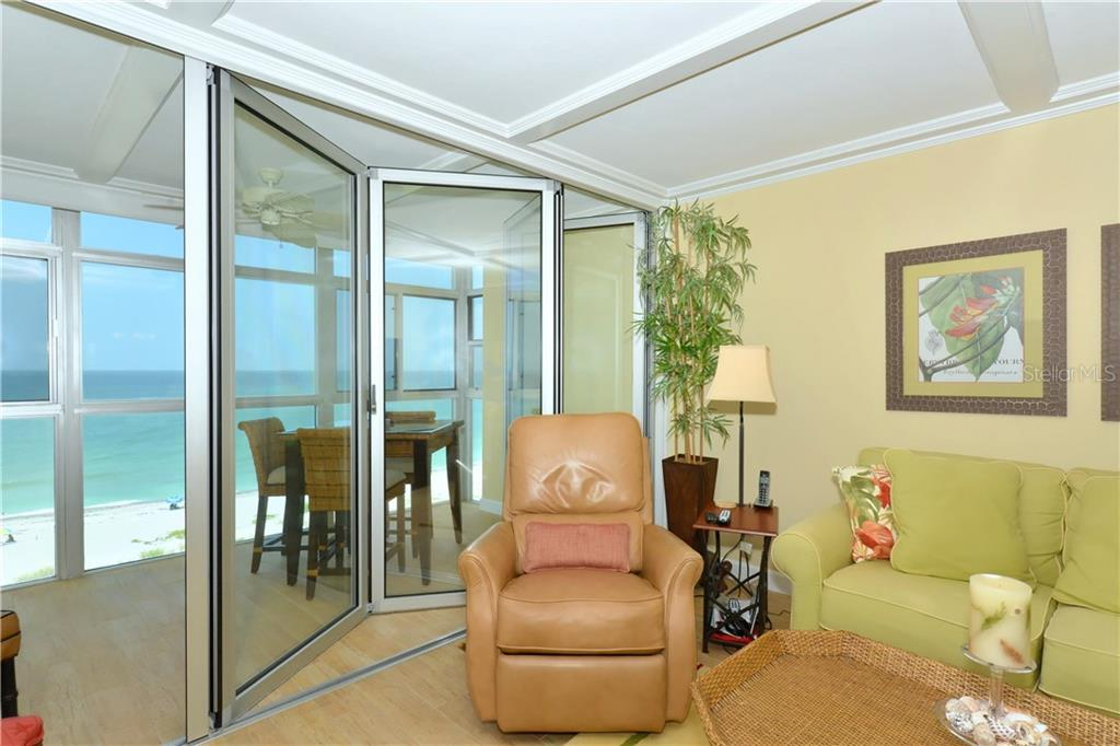 Partially closed Nana-Wall.  Has 4 panels. - Condo for sale at 255 The Esplanade N #706, Venice, FL 34285 - MLS Number is N5913875