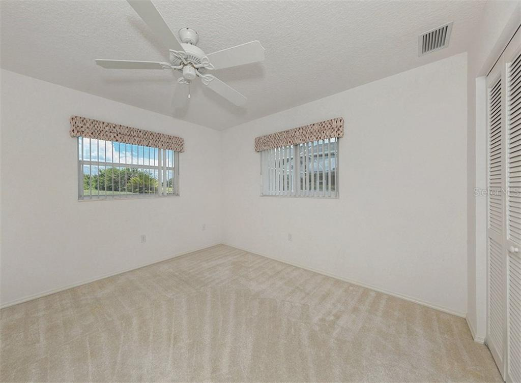 Bedroom 2 - Single Family Home for sale at 683 May Apple Way, Venice, FL 34293 - MLS Number is N5913909