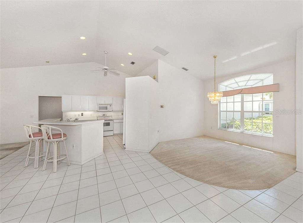 KItchen/dining room - Single Family Home for sale at 683 May Apple Way, Venice, FL 34293 - MLS Number is N5913909