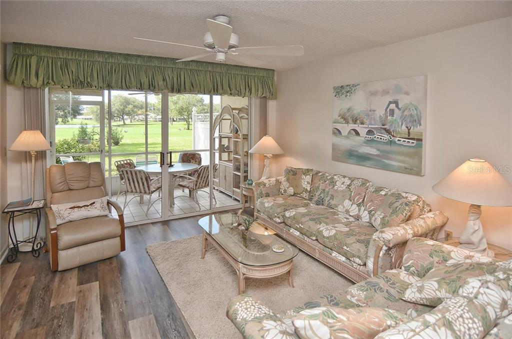 Living room to lanai - Condo for sale at 811 Wexford Blvd #811, Venice, FL 34293 - MLS Number is N5914092