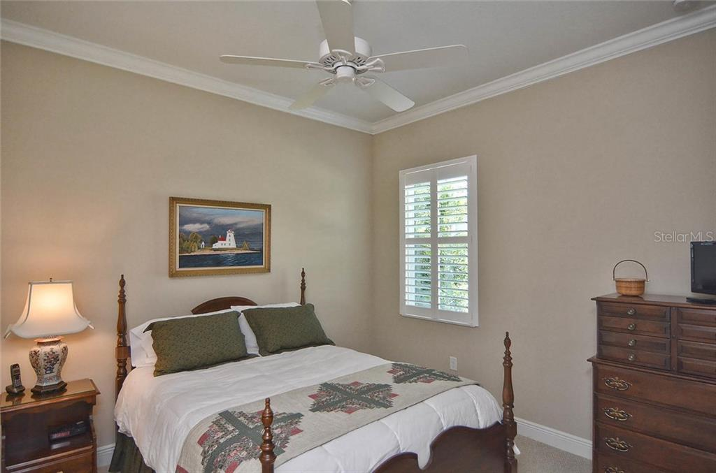 Bedroom 2 - Single Family Home for sale at 293 Marsh Creek Rd, Venice, FL 34292 - MLS Number is N5914238