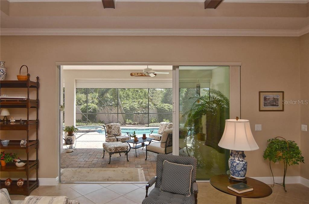 Great room to lanai and pool - Single Family Home for sale at 293 Marsh Creek Rd, Venice, FL 34292 - MLS Number is N5914238