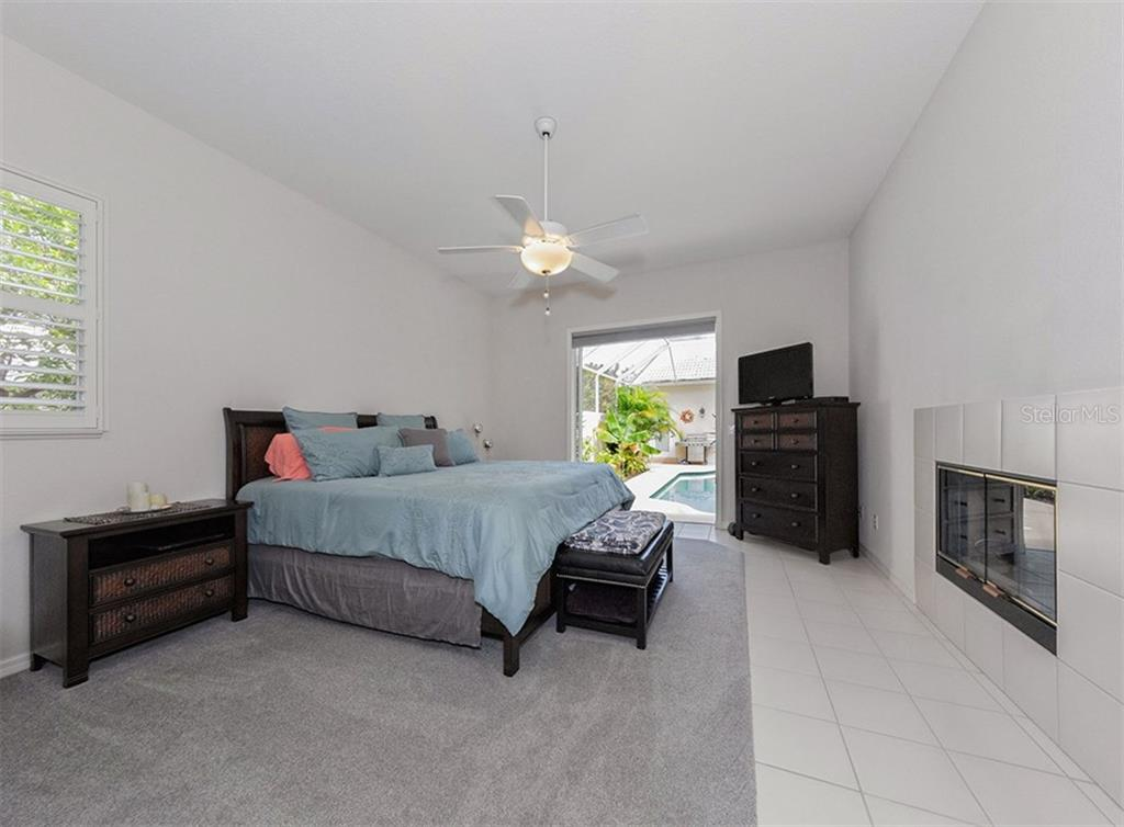 Master bedroom to pool - Single Family Home for sale at 530 Waterwood Ln, Venice, FL 34293 - MLS Number is N5914538
