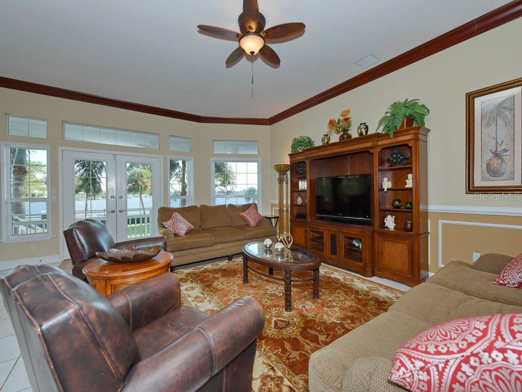 Great Room area with breathtaking views of Roberts Bay. - Single Family Home for sale at 200 Sunrise Dr, Nokomis, FL 34275 - MLS Number is N5914820