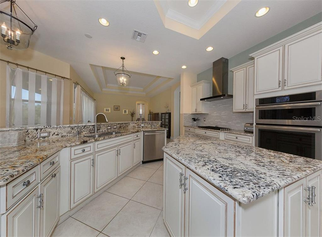 Kitchen - Single Family Home for sale at 221 Portofino Dr, North Venice, FL 34275 - MLS Number is N5914925