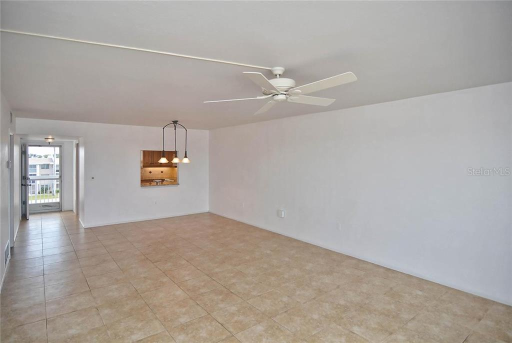 Living/dining room to foyer/entry. - Condo for sale at 333 The Esplanade N #402, Venice, FL 34285 - MLS Number is N5914981
