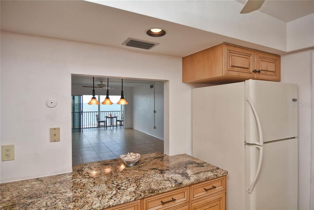 Kitchen pass through to dining room - Condo for sale at 333 The Esplanade N #402, Venice, FL 34285 - MLS Number is N5914981