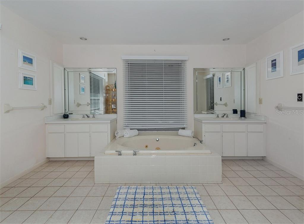 Master bathroom with dual sinks and garden tub - Single Family Home for sale at 3509 Casey Key Rd, Nokomis, FL 34275 - MLS Number is N5915098