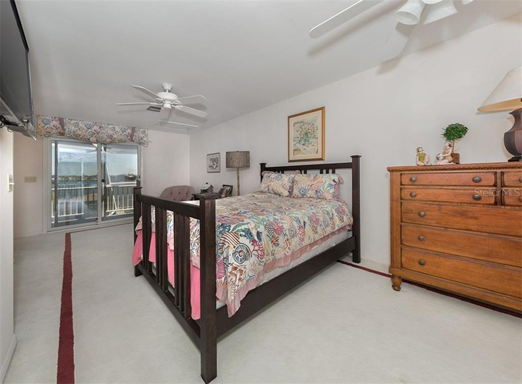 Guest bedroom features balcony overlooking the bay. This room also features a private bath and separate private balcony with beach views. - Single Family Home for sale at 3509 Casey Key Rd, Nokomis, FL 34275 - MLS Number is N5915098