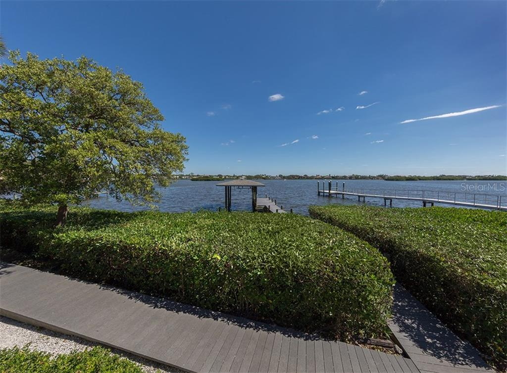 View towards the bay and private dock. - Single Family Home for sale at 3509 Casey Key Rd, Nokomis, FL 34275 - MLS Number is N5915098
