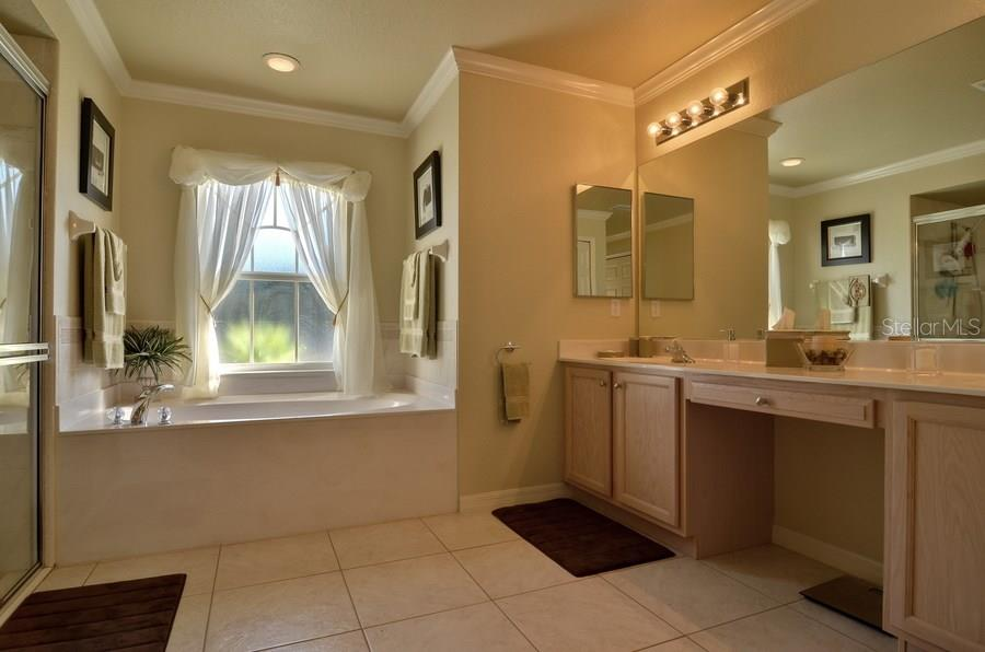 Master Bath. dual sinks, separate shower and tub and toilet - Single Family Home for sale at 4265 Irdell Ter, North Port, FL 34288 - MLS Number is N5915255
