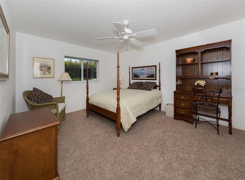 Bedroom 2 - Single Family Home for sale at 866 Wood Sorrel Ln, Venice, FL 34293 - MLS Number is N5915362