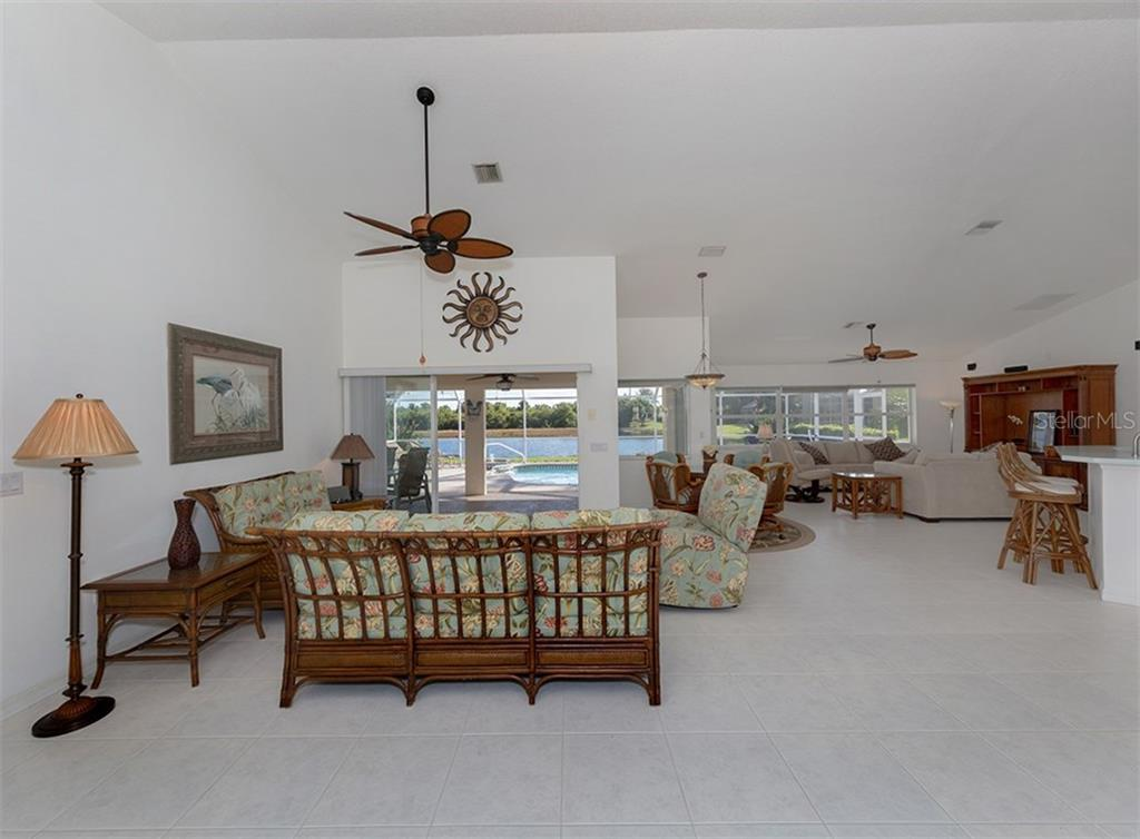 Living room, breakfast nook, family room - Single Family Home for sale at 866 Wood Sorrel Ln, Venice, FL 34293 - MLS Number is N5915362