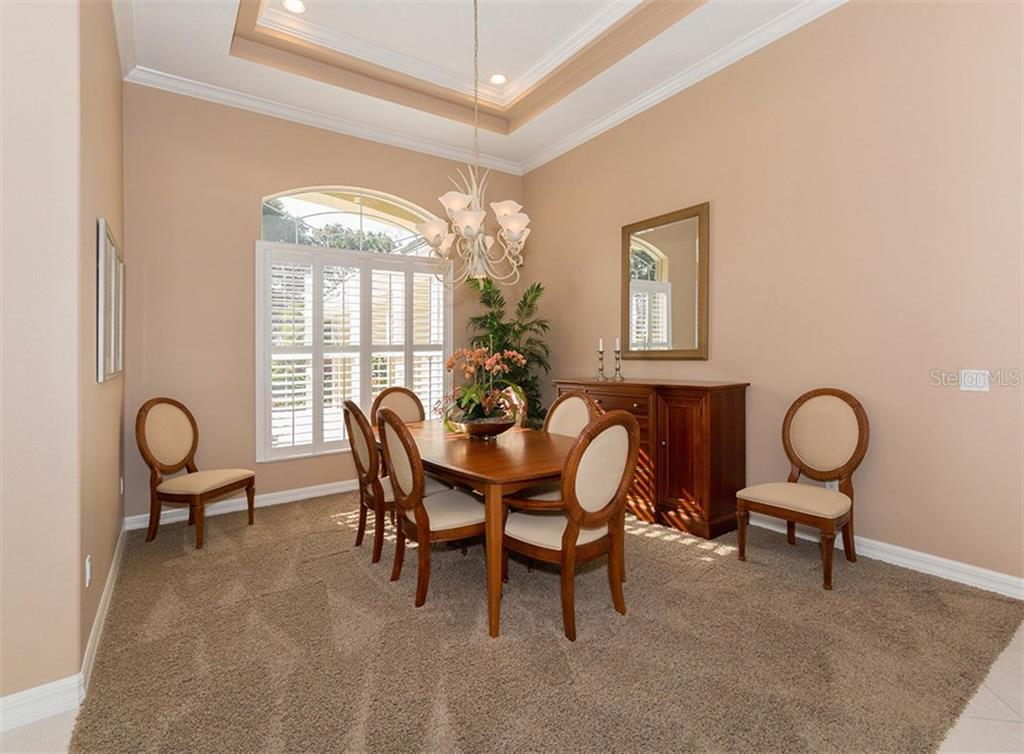 Dining room - Single Family Home for sale at 431 Tremingham Way, Venice, FL 34293 - MLS Number is N5915386