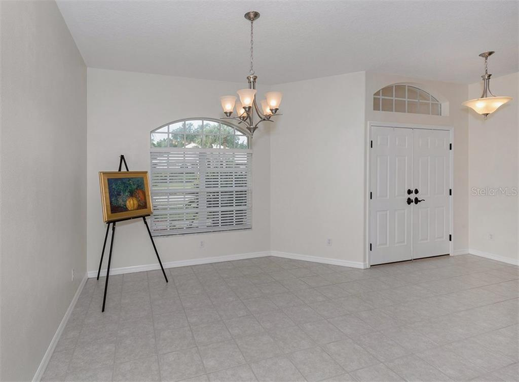 Dining room/front entry - Single Family Home for sale at 2196 Calusa Lakes Blvd, Nokomis, FL 34275 - MLS Number is N5915879