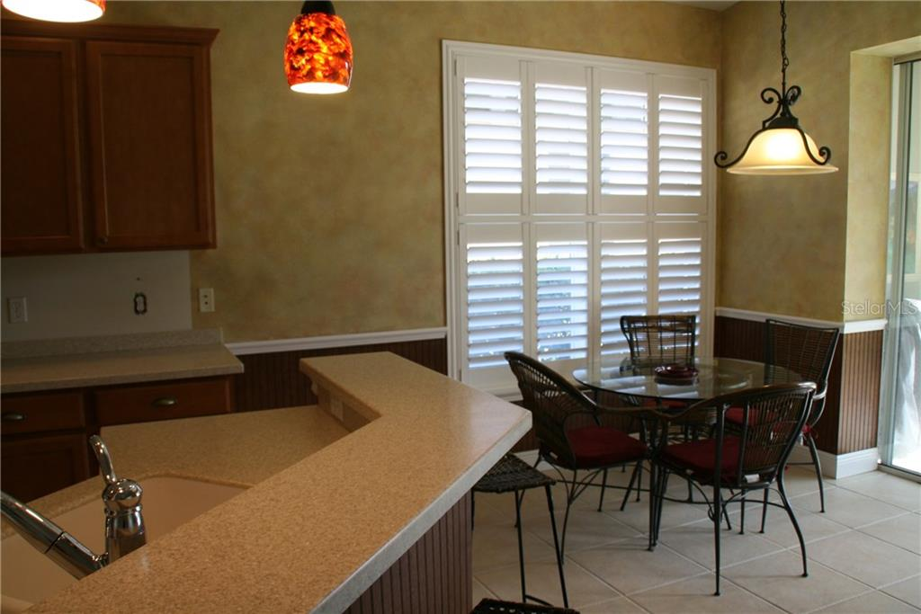 Kitchen/dinette - Single Family Home for sale at 23900 Waverly Cir, Venice, FL 34293 - MLS Number is N5916470