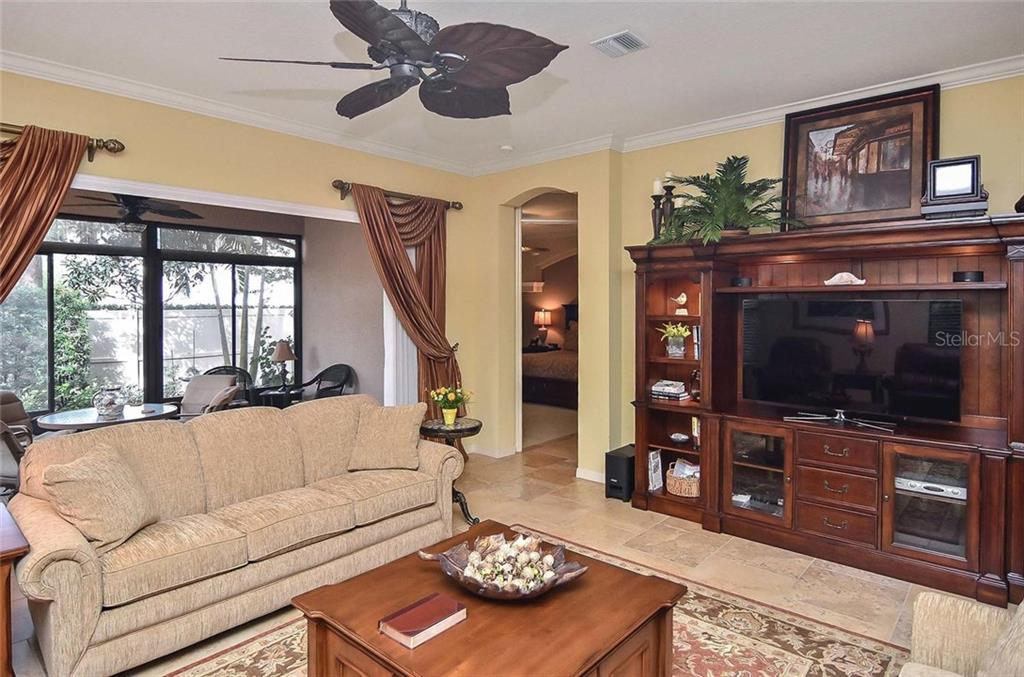 Living room to lanai and master bedroom - Single Family Home for sale at 769 Sawgrass Bridge Rd, Venice, FL 34292 - MLS Number is N5916484