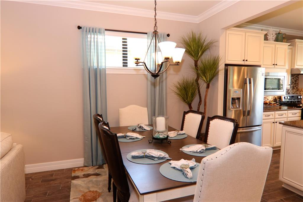 Dining Room - Single Family Home for sale at 13880 Lido St, Venice, FL 34293 - MLS Number is N5917319