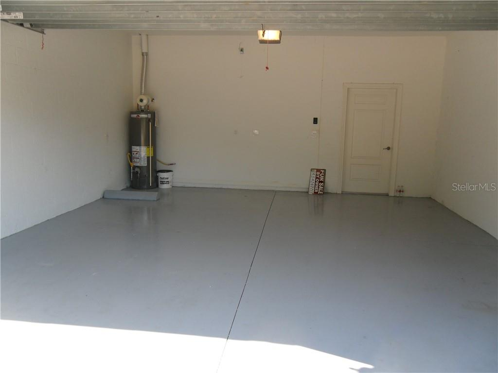 Large Two Car Garage With Sealed Floor - Villa for sale at 10731 Trophy Dr, Englewood, FL 34223 - MLS Number is N6100149