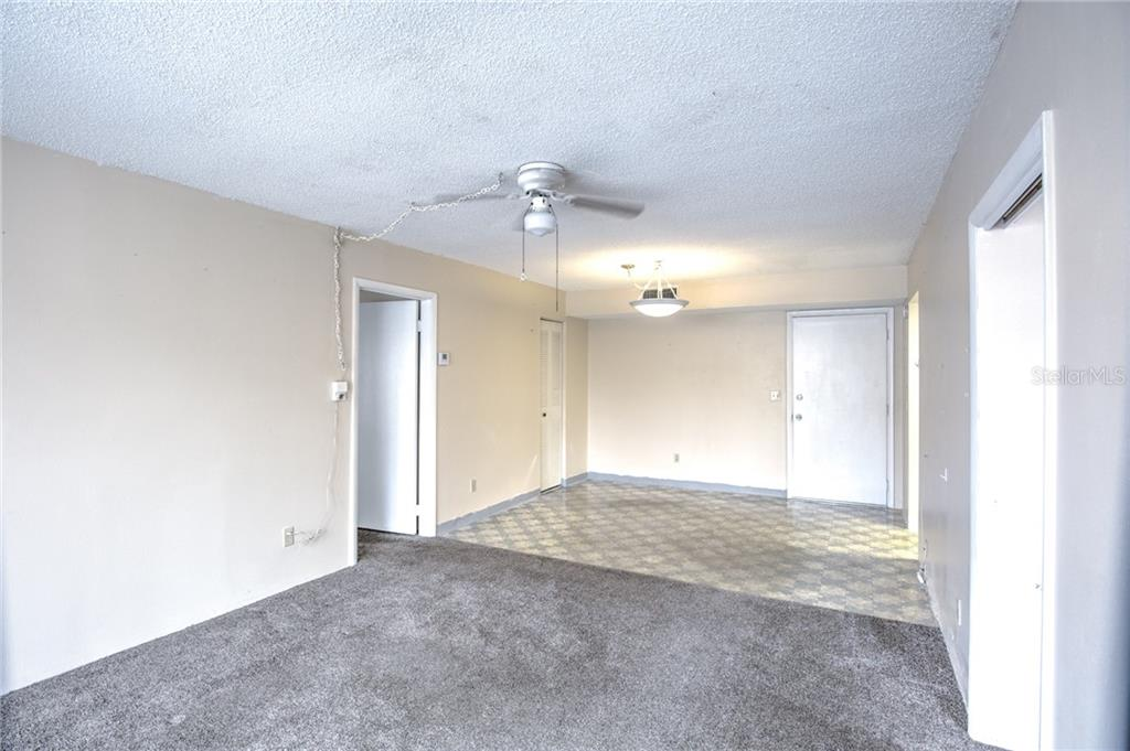 Living room to dining room - Condo for sale at 519 Albee Farm Rd #117, Venice, FL 34285 - MLS Number is N6100461