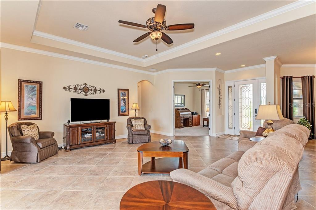Living area to den and front entrance - Single Family Home for sale at 20145 Cristoforo Pl, Venice, FL 34293 - MLS Number is N6100537