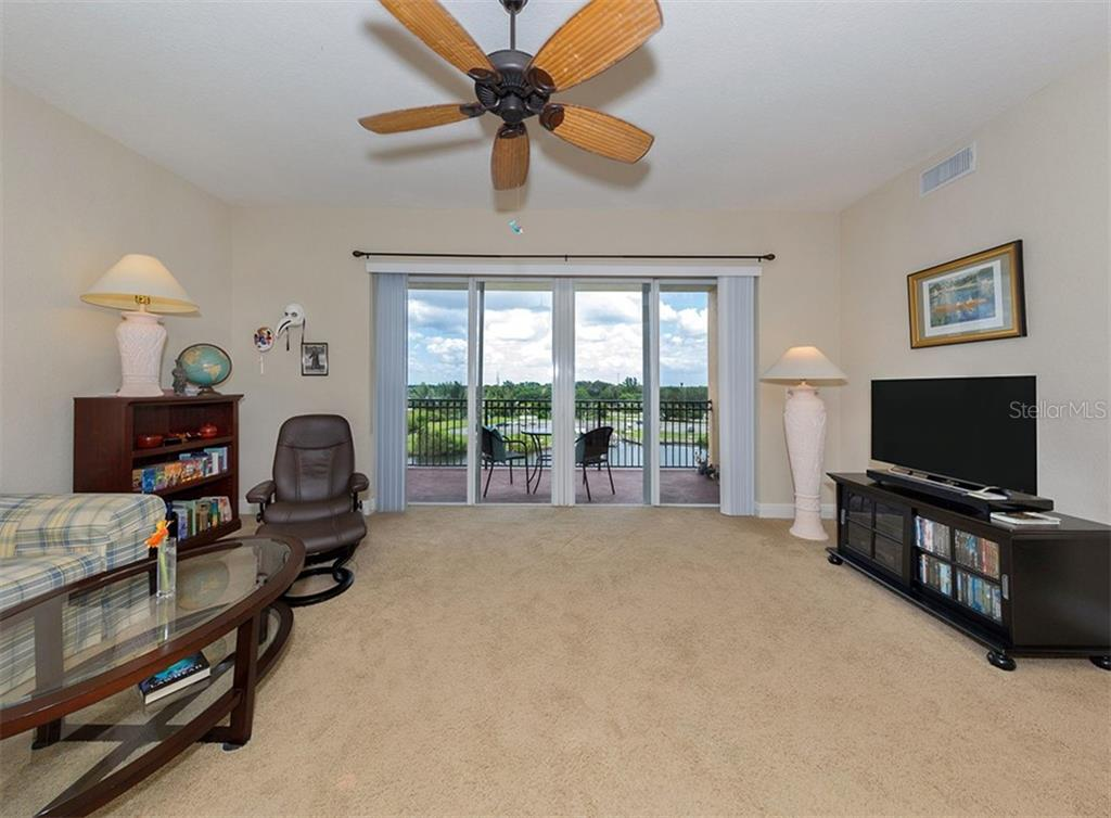 Living room with sliders to balcony - Condo for sale at 167 Tampa Ave E #612, Venice, FL 34285 - MLS Number is N6100834