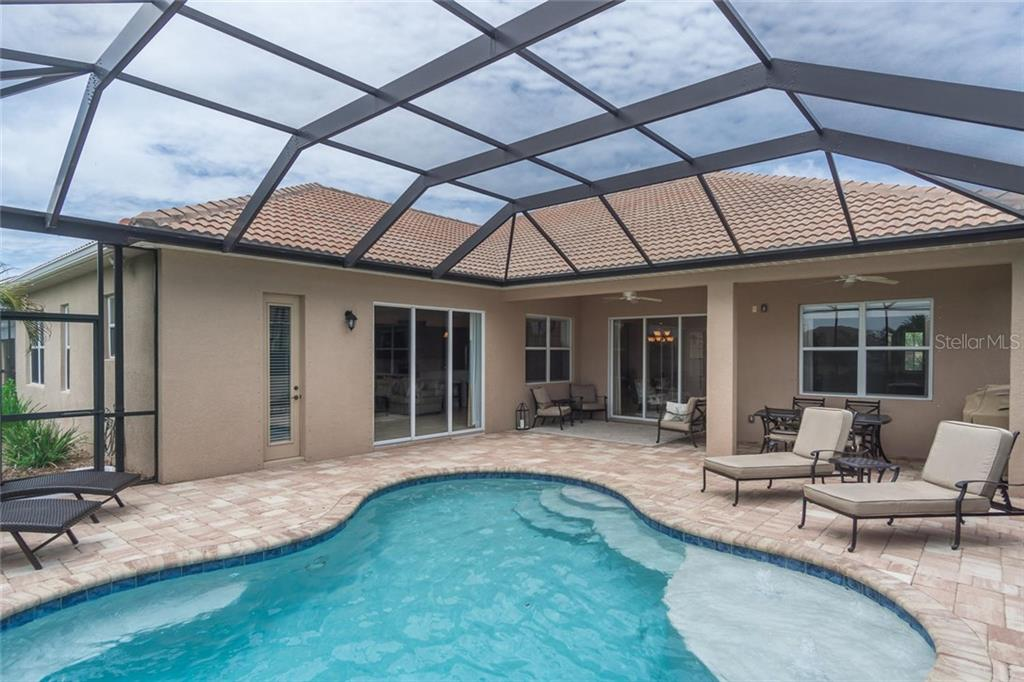 Covered lanai and pool deck - Single Family Home for sale at 368 Marsh Creek Rd, Venice, FL 34292 - MLS Number is N6101204