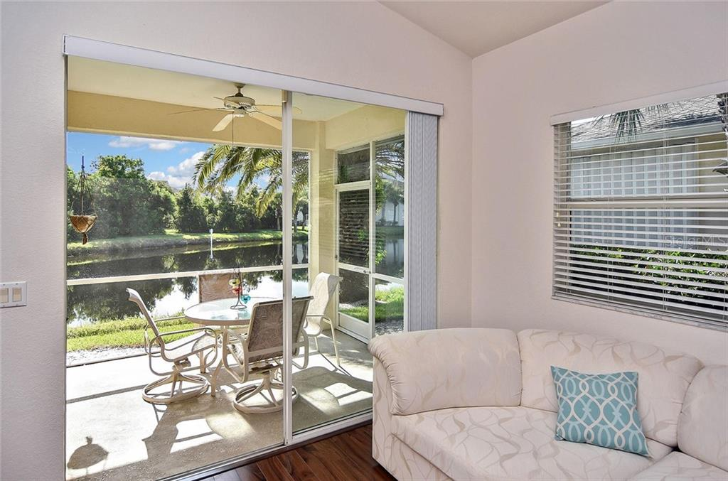 Living room to screened lanai - Villa for sale at 1720 Fountain View Cir, Venice, FL 34292 - MLS Number is N6101363