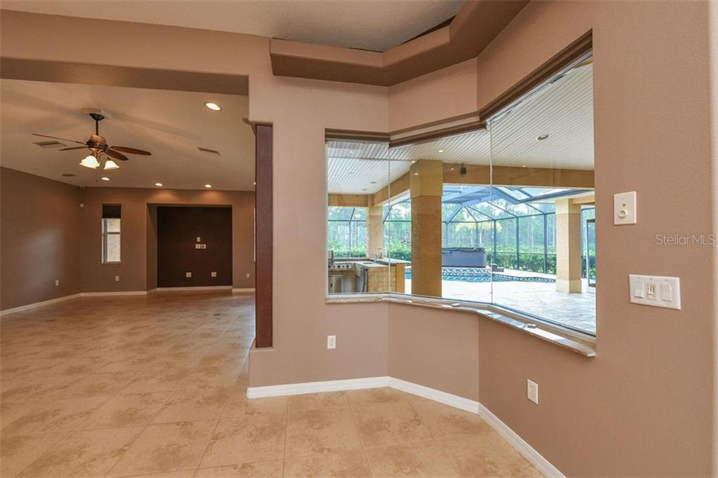 Dinette, family room - Single Family Home for sale at 9150 Deer Ct, Venice, FL 34293 - MLS Number is N6101408