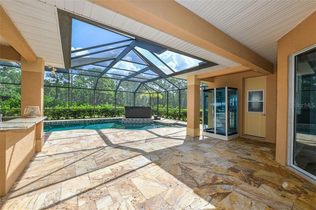 Lanai to pool - Single Family Home for sale at 9150 Deer Ct, Venice, FL 34293 - MLS Number is N6101408