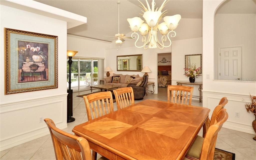 Dining room to living room - Single Family Home for sale at 5887 Wilson Rd, Venice, FL 34293 - MLS Number is N6101910