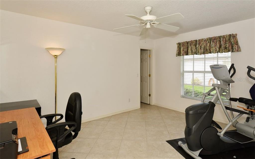 Bedroom 2/office - Single Family Home for sale at 5887 Wilson Rd, Venice, FL 34293 - MLS Number is N6101910