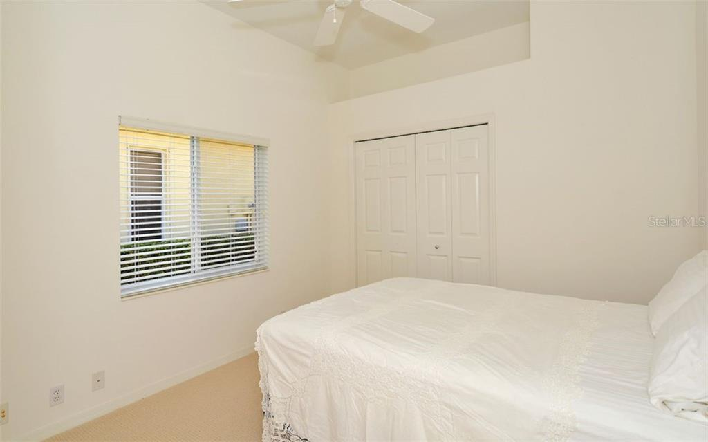 2nd bedroom (includes custom closet system - Single Family Home for sale at 1018 Grouse Way, Venice, FL 34285 - MLS Number is N6101913