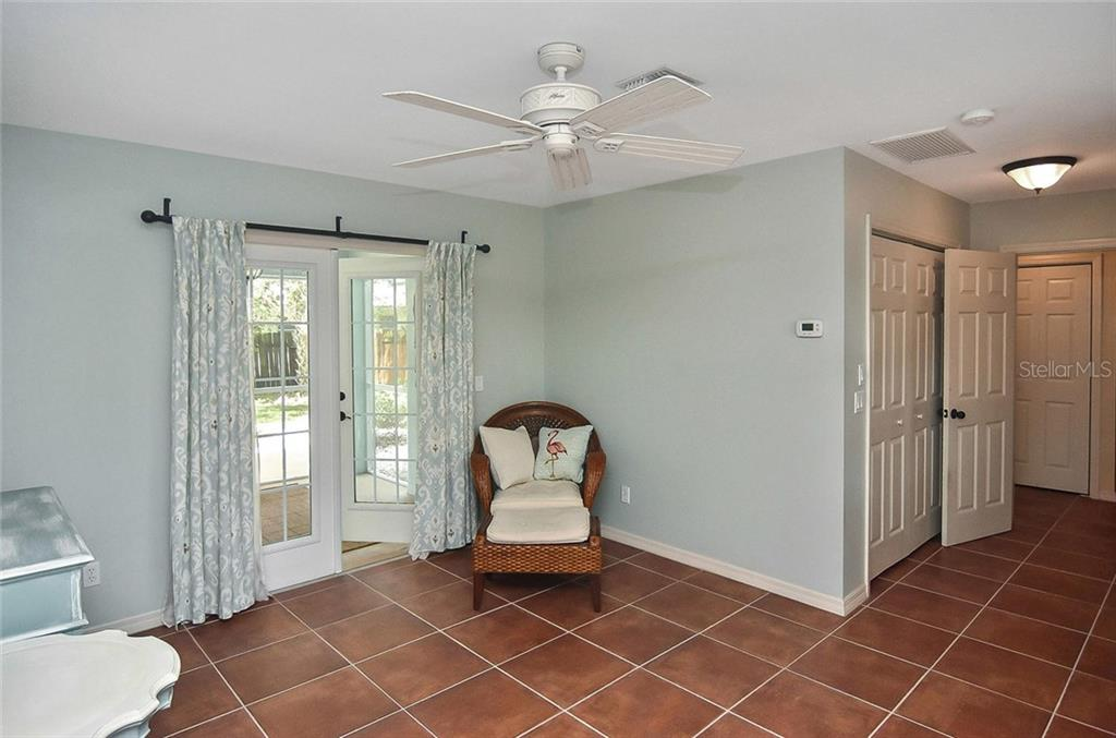 Spacious master bedroom suite has room for a reading nook. - Single Family Home for sale at 316 Alba St E, Venice, FL 34285 - MLS Number is N6102095