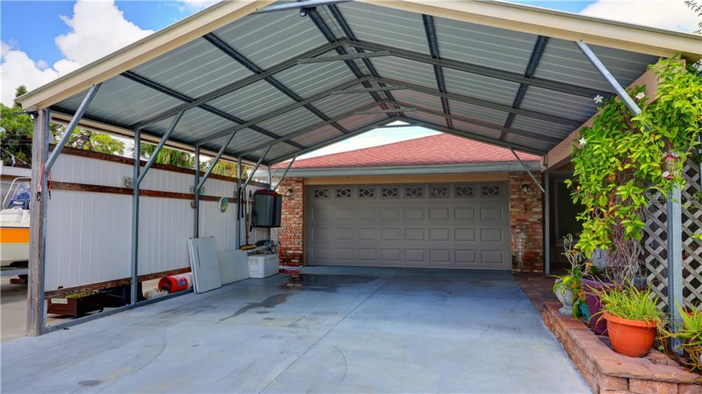 Large Car Port to Protect vehicles from FL Sun. - Single Family Home for sale at 401 Shamrock Blvd, Venice, FL 34293 - MLS Number is N6102109