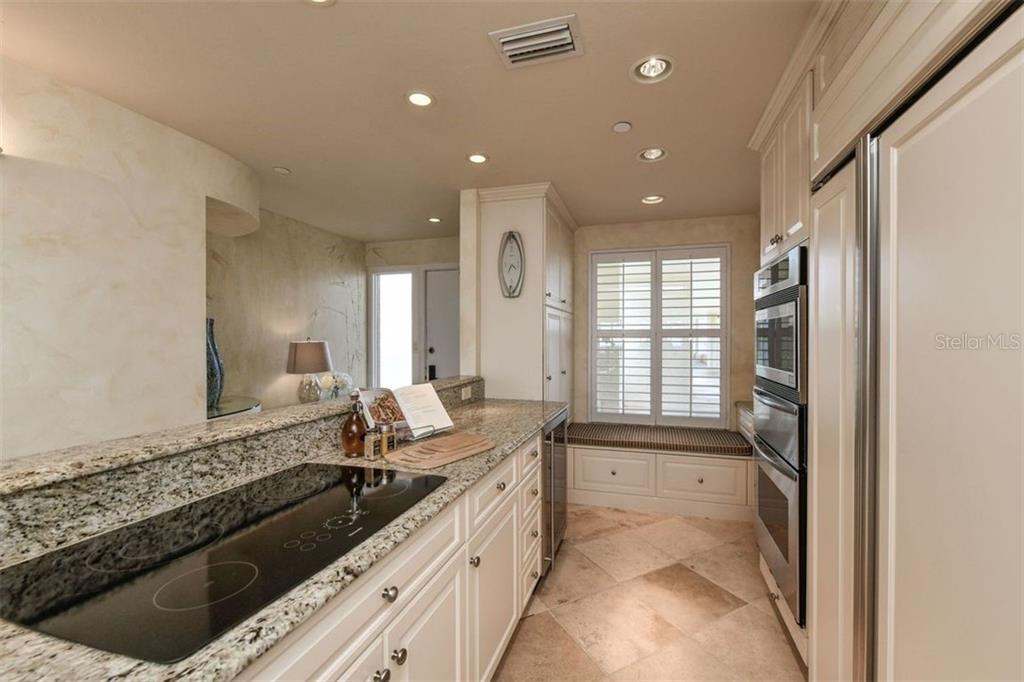 KITCHEN AREA HAS LOTS OF STORAGE, COUNTER SPACE AND CERAMIC COOKTOP - Condo for sale at 5740 Midnight Pass Rd #505 F, Sarasota, FL 34242 - MLS Number is N6102195