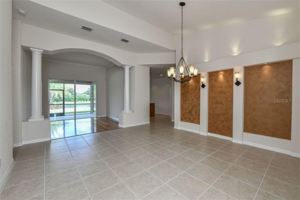 Single Family Home for sale at 12070 Granite Woods Loop, Venice, FL 34292 - MLS Number is N6102226