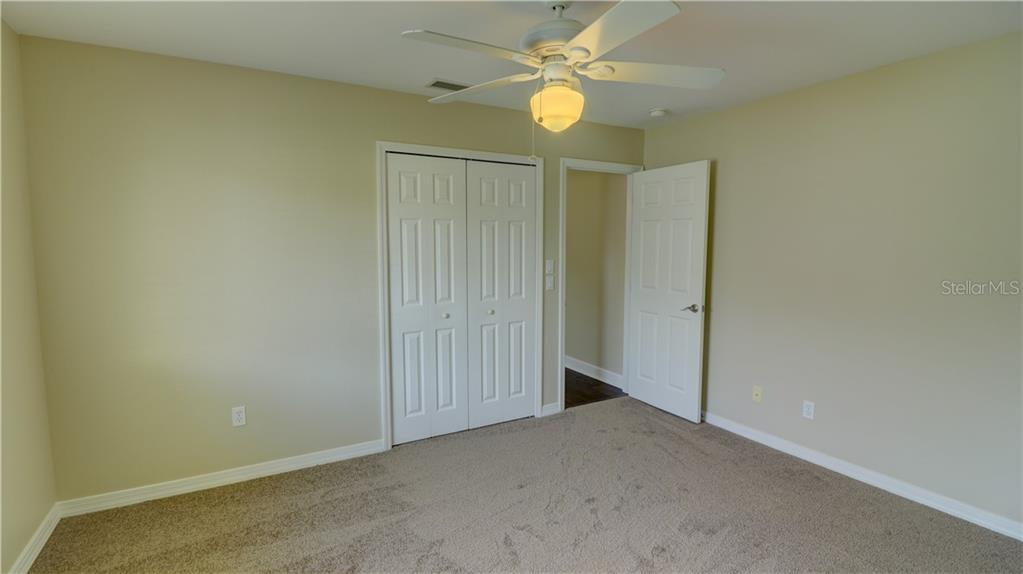 Bedroom 2 closet - Single Family Home for sale at 409 Palm Ave, Nokomis, FL 34275 - MLS Number is N6102313
