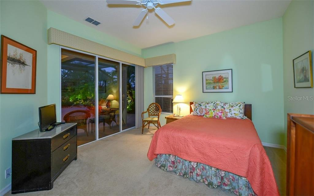 Bedroom 2 with sliding doors to lanai - Single Family Home for sale at 820 Adonis Pl, Venice, FL 34292 - MLS Number is N6102472