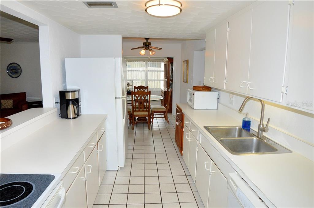 Galley kitchen to dining room - Single Family Home for sale at 609 Armada Rd N, Venice, FL 34285 - MLS Number is N6102952