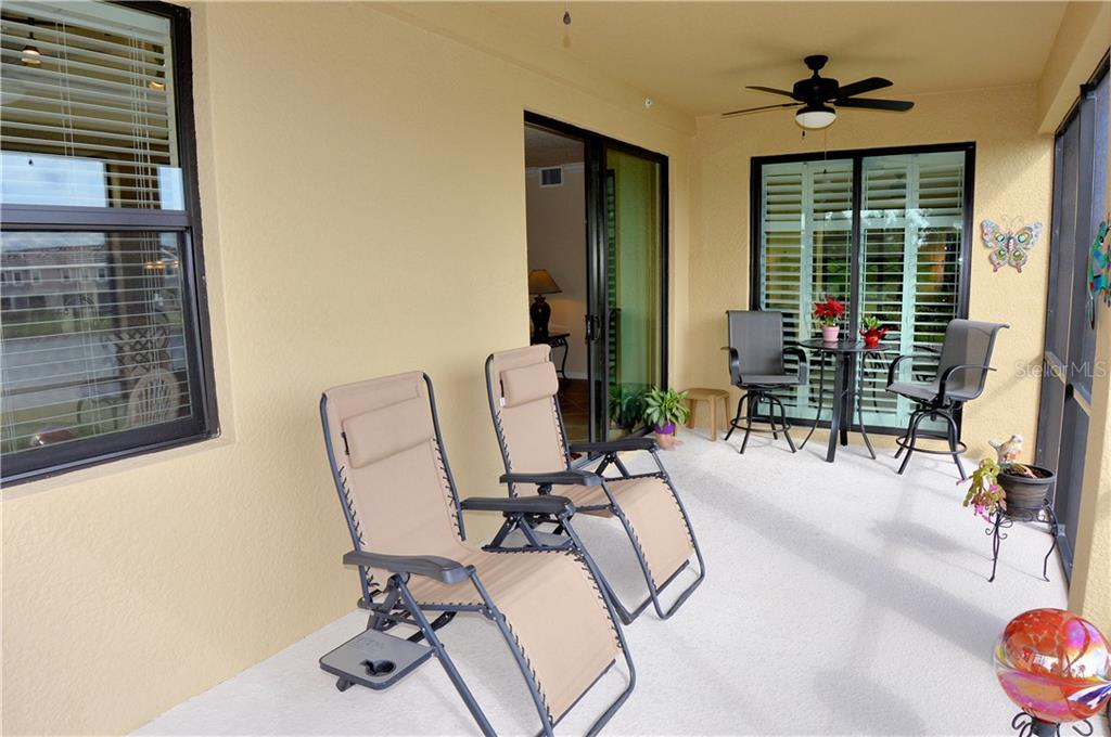 Lania with sliders to living room and master bedroom - Condo for sale at 20140 Ragazza Cir #102, Venice, FL 34293 - MLS Number is N6103394