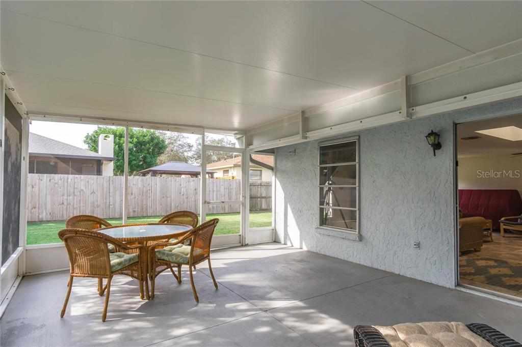 Covered(with insulated SIPS panels)screen lanai, sliding glass doors to family room. - Single Family Home for sale at 3656 Clematis Rd, Venice, FL 34293 - MLS Number is N6103558