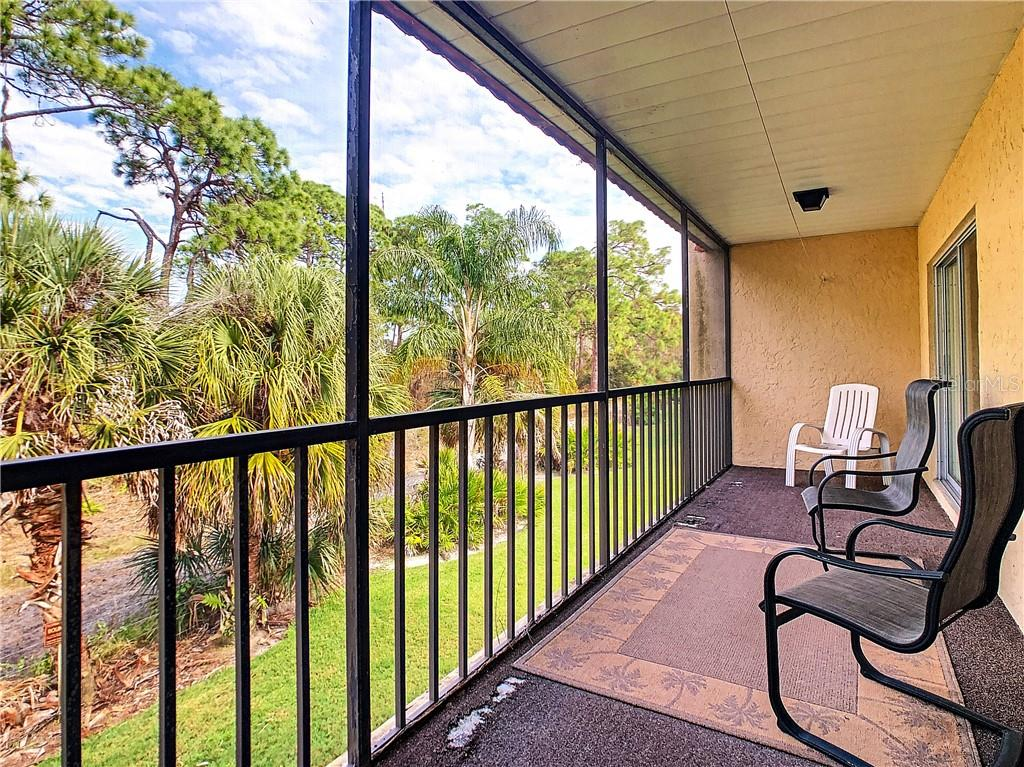 Large screened lanai overlooking Oscar Scherer State Park - Condo for sale at 211 Rubens Dr #h, Nokomis, FL 34275 - MLS Number is N6103629
